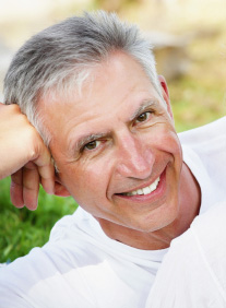 Man with a single tooth veneer is considering more veneers for teeth at The Carrollton Dentist's office near The Colony.