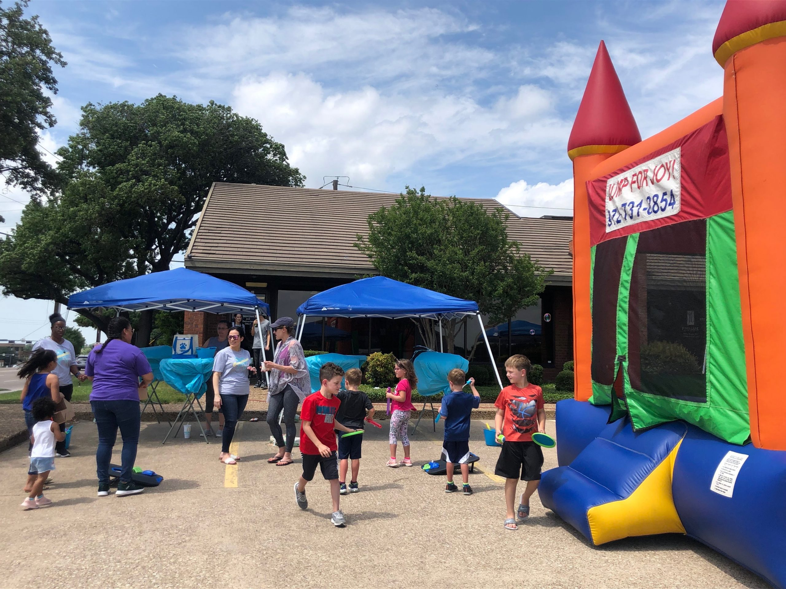 The Carrollton Dentist gets a bounce house, DJ, and food truck for its block party.